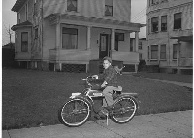 Boy posing on a bicycle, Seattle, circa 1950