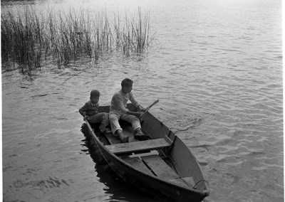 Butch Smith and Sonny Norris sitting in rowboat, Seattle, July 4, 1947