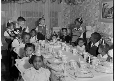 Children around table at birthday party, Seattle, circa 1955