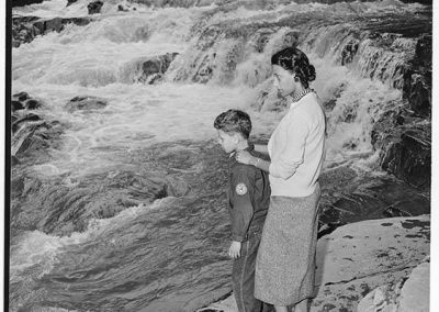 Izzie and Butch Smith standing on rocks, Granite Falls, circa 1953