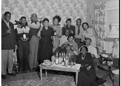 Party group posing with raised glasses, Seattle, circa 1953